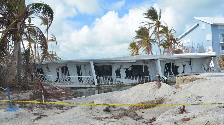 Complete collapse of a single-family home on a slab foundation in Islamorada, Florida.